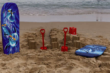 sandcastles: boards, buckets and spade with sandcastles on the beach at courtown, wexford, ireland Stock Photo