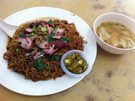 Dry wan ton noodles with dumpling soup Stock Photo
