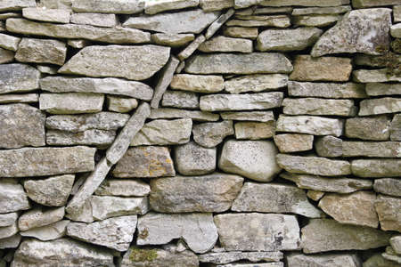 dry stone: Curved circular texture pattern in a dry stone wall Stock Photo