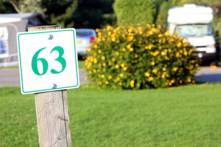 camping pitch: Camp site pitch marker with the number 63