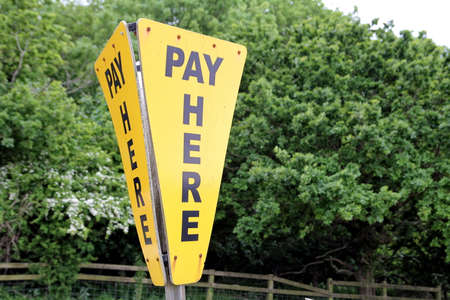 point of demand: Pay here sign