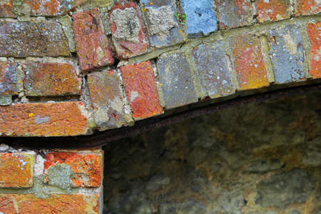 reclaiming: brick pattern on old derelict fireplace Stock Photo