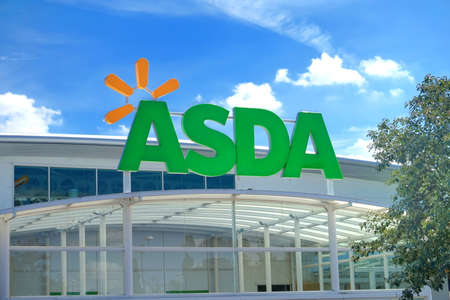 frugal: BASINGSTOKE, UK - JULY 20, 2016: Store front of the ASDA supermarket in Brighton Hill