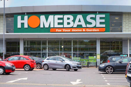 home improvement store: BASINGSTOKE, UK - JULY 20, 2016: Entrance and car park of the HomeBase DIY home improvement store Editorial