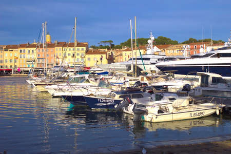 jetset: ST TROPEZ, FRANCE, JUNE 04 2016: Modern boats in the harbour in front of traditional Provence houses