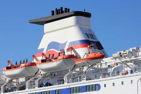 lifeboats: PORTSMOUTH, ENGLAND - MARCH 16 2016: Channel ferry lifeboats and tower against a blue sky. Editorial