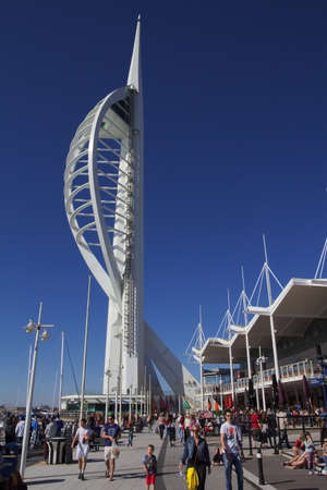 spinnaker: GUNWHARF KEYS, ENGLAND - MARCH 16 2016: Spinnaker Tower with tourists and shoppers