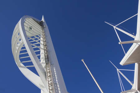 spinnaker: GUNWHARF KEYS, ENGLAND - MARCH 16 2016: Spinnaker Tower against blue sky Editorial
