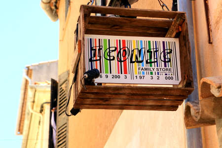 tropez: SAINT-TROPEZ, PROVENCE, FRANCE - AUGUST 21, 2016: Unusual barcode sign in an old box, for the ICONIC FAMILY STORE in St Tropez Editorial