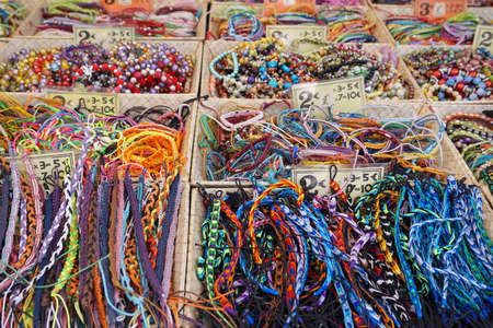 var: St AYGULF, VAR, PROVENCE, FRANCE: Provencal market stall selling beads, armbands and other items in many multi colors Stock Photo