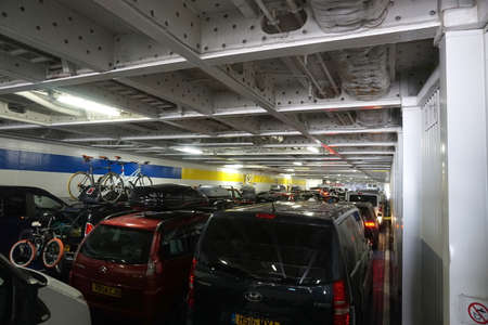 disembark: CALAIS, FRANCE, AUGUST 10 2016: Holidaymakers cars waiting to disembark from the cross channel ferry to France
