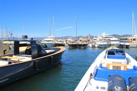 tropez: SAINT-TROPEZ, PROVENCE, FRANCE - AUGUST 21, 2016: Powerful motorboats moored in the new port at St Tropez Editorial