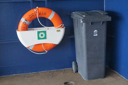calais: CALAIS, FRANCE, AUGUST 10 2016: Life belt and waste bin on the cross channel ferry to France