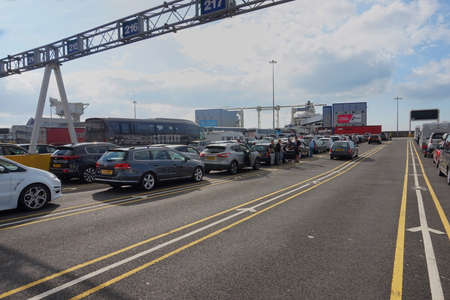 dover: DOVER, KENT, ENGLAND, AUGUST 10 2016: Holidaymakers cars queuing to board the cross channel ferry to France Editorial