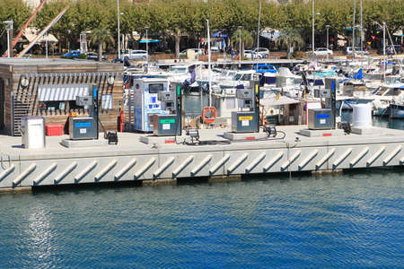 unleaded: SAINT-RAPHAEL, PROVENCE, FRANCE - AUGUST 21 2016: Marine boat filling station selling regular and Tax Free Unleaded (Sans Plomb) and Diesel (Gazole) in the harbor at Saint-Raphael, on the French Riviera