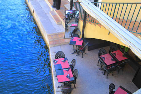 rialto: PORT GRIMAUD, PROVENCE, FRANCE - AUGUST 23 2016: Overhead view of the Rialto Pizza Restaurant in this pretty French Riviera village built on the water Editorial