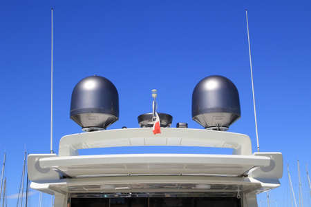 SAINT-TROPEZ, PROVENCE, FRANCE - AUGUST 21, 2016: Masts and navigational equipment on top of an expensive luxury yacht moored in the port of St Tropez Editorial