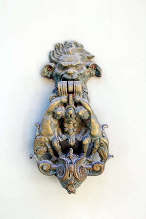 Gothic door knocker with cherubs and monster face and number thirty four