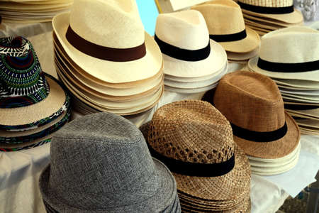 varied: Straw fedora hats for men in varied colors and designs on a market stall
