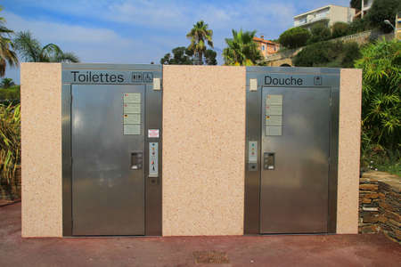 outhouse: LE LAVANDOU, PROVENCE, FRANCE - AUGUST 17 2016: Automatic self cleaning public toilets which are common on the French Riviera