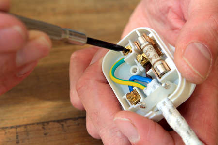 Rewiring a UK 13 amp domestic electric plug Stock Photo