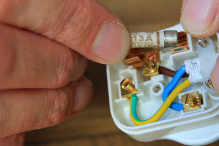 replacing the fuse in a uk 13 amp domestic electric plug stock photo rh 123rf com Wiring a Plug End 3 Prong Plug Wiring Diagram