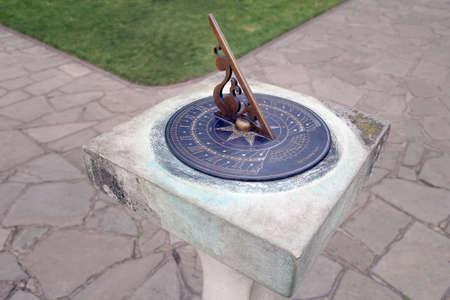sundial: Brass sundial on stone pedestal