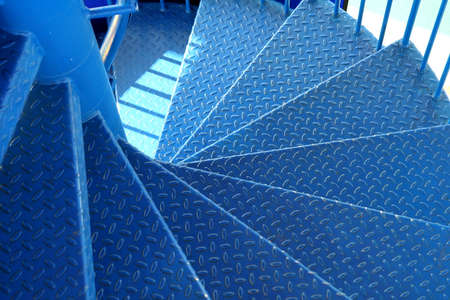 treads: Blue metal spiral staircase