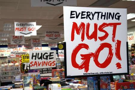 Basingstoke, UK - Jan 04 2016: Retail shop sale signs saying Everything Must Go, Huge Savings