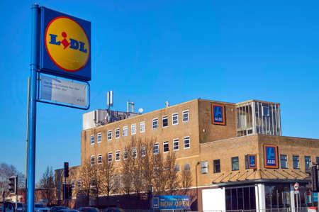 Blackwater, UK - 21 Jan 2017: Exterior shop front of the ALDI store, with the sign for competitor LIDL in the foreground. ALDI and LIDL are famous German discount supermarket