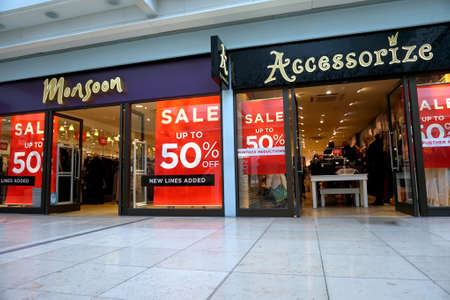 fronts: Basingstoke, UK - January 04 2017: Shop fronts of Monsoon and Accessorize fashion stores with 50% off Sale signs