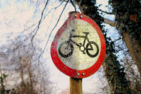 British No Cycling sign with pellet marks from being used as air rifle target practice   Stock Photo
