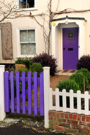 english house: Purple gate and front door on an old Georgian English house