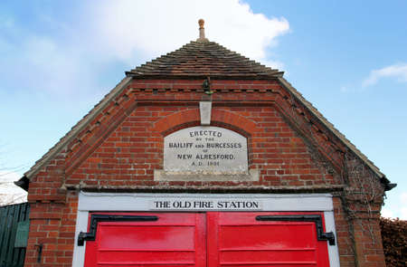 New Alresford, UK - Jan 28 2017 : The disused Old Fire Station in New Alresford, Hampshire UK. An old traditional Victorian red brick and tile building with red wooden doors. Sajtókép