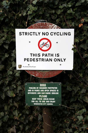 strictly: New Alresford, UK - Jan 28 2017: Strictly no cycling sign, and dog fouling sign, on a pedestrian path in Hampshire, England, UK Editorial