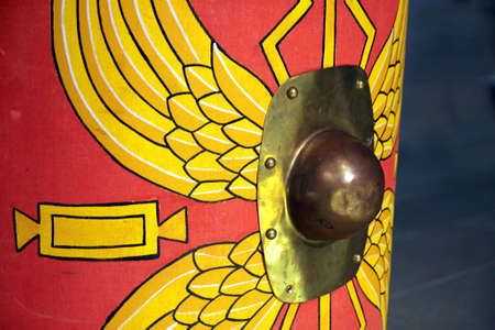 Detail of a reproduction Roman scutum shield with red and yellow wing pattern