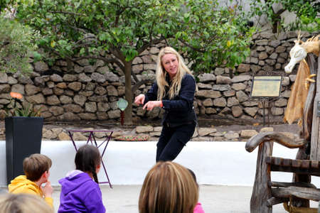 Bodelva, Cornwall, UK - April 4 2017: Story teller entertaining children and families at the Eden Project Environmental exhibition in Cornwall, England