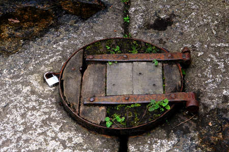 Old rustic wooden trap door with padlock Stock Photo