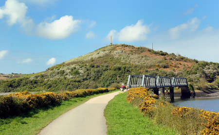 Iron railway bridge on the Camel Trail now used as a leisure route for cyclists and walkers Stock Photo