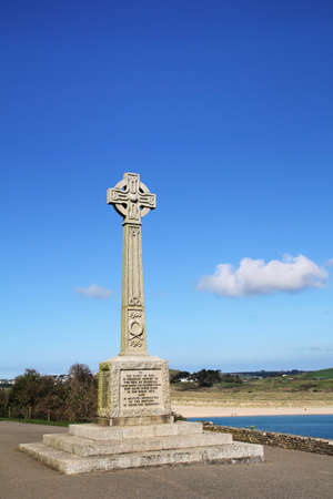 War memorial for the Great War of 1914 - 1918 on a promenade overlooking the English coast, blue sky with white clouds Stock Photo