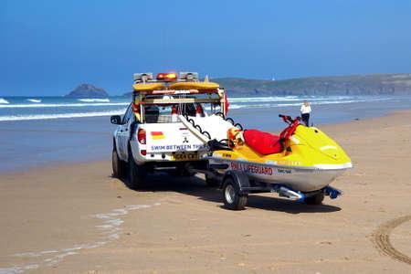 salvavidas: Newquay, Cornwall, UK - April 7 2017: RNLI Lifeguard truck and jetski on a Cornish surfing beach at Newquay