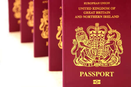 Five British United Kingdom European Union Biometric passports stood as if queueing