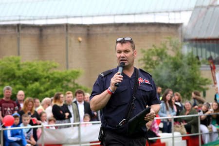 sniffer: Beaulieu, Hampshire, UK - May 29 2017: Fire Dog handler of the Hampshire Arson Task Force addressing the crowd during the 2017 999 Show