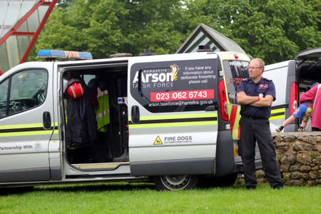 sniffer: Beaulieu, Hampshire, UK - May 29 2017: Fire sniffer dog van and officer belonging to the Hampshire Arson Task Force