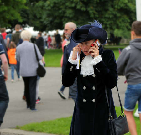 Beaulieu, Hampshire, UK - May 29 2017: High Sheriff of Hampshire the Hon Mrs Mary Montagu-Scott on her mobile phone at the 2017 999 Show