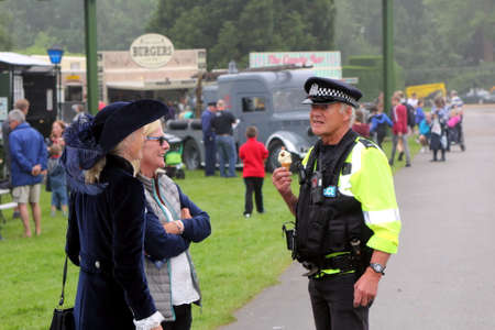hon: Beaulieu, Hampshire, UK - May 29 2017: UK Police officer talking to the Right Hon. Mary Montagu-Scott and a friend at the 2017 999 Show Editorial