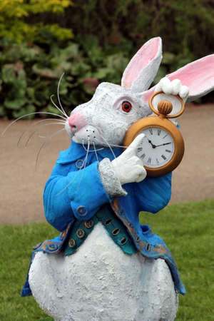 fictional: Wisley, Surrey, UK - April 30 2017: Garden ornament or statue of the White Rabbit from Alice in Wonderland Editorial