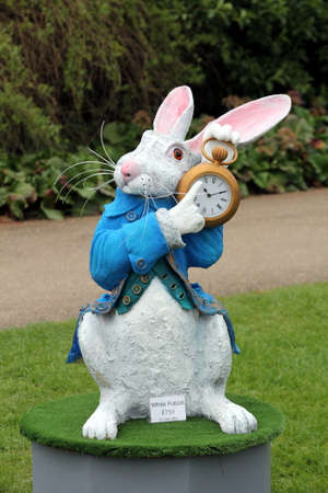 Wisley, Surrey, UK - April 30 2017: Garden ornament or statue of the White Rabbit from Alice in Wonderland Editorial