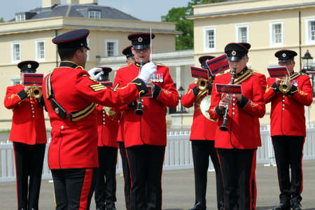 Sandhurst, UK - June 18 2017: Conductor and musicians of the Military Band of the Corps of Royal Engineers
