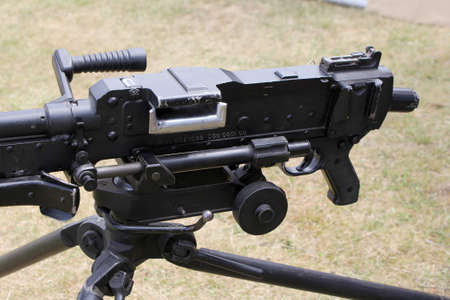tripod mounted: Close up of an L7A2 GPMG GIMPY General Purpose Machine Gun mounted on tripod